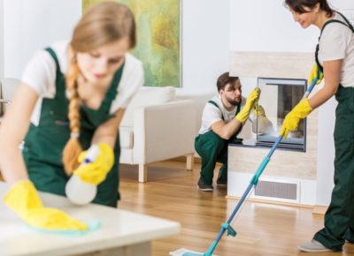 54189659_xxl-Three-young-professional-cleaners-in-uniforms-cleaning-spacious-living-room-1024x683